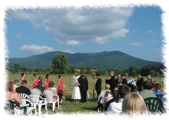 Ceremony in pasture field with Blue Ridge Mountain background